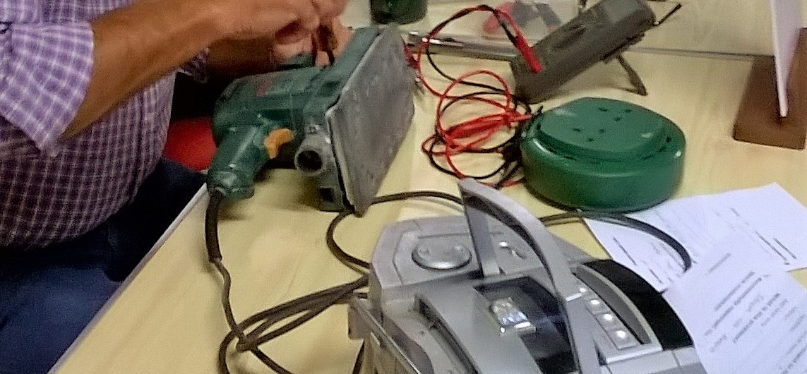 Electric sander being fixed at Tiverton Repair Café